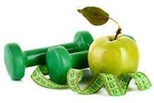image d'une pomme verte avec deux halteres verte et un ruban vert