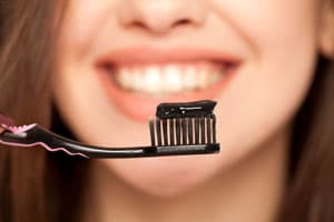 Whiten teeth with charcoal toothpaste